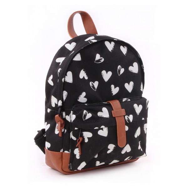 Ryggsäck för små barn, svart med vita hjärtan. Bra för fritids, dagis, första skolåren.